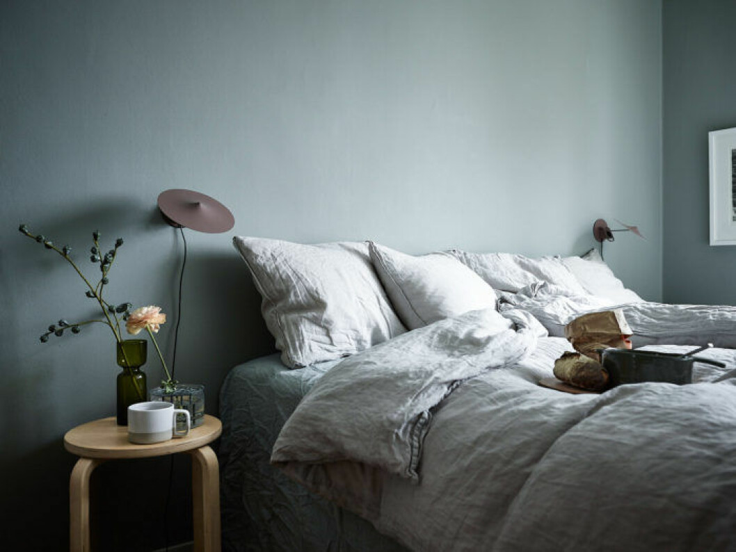 Bedroom with painted green and blue walls.
