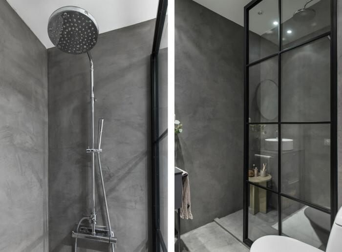 Industrivägg i glas som duschvägg och väggar och golv i microcement i badrum