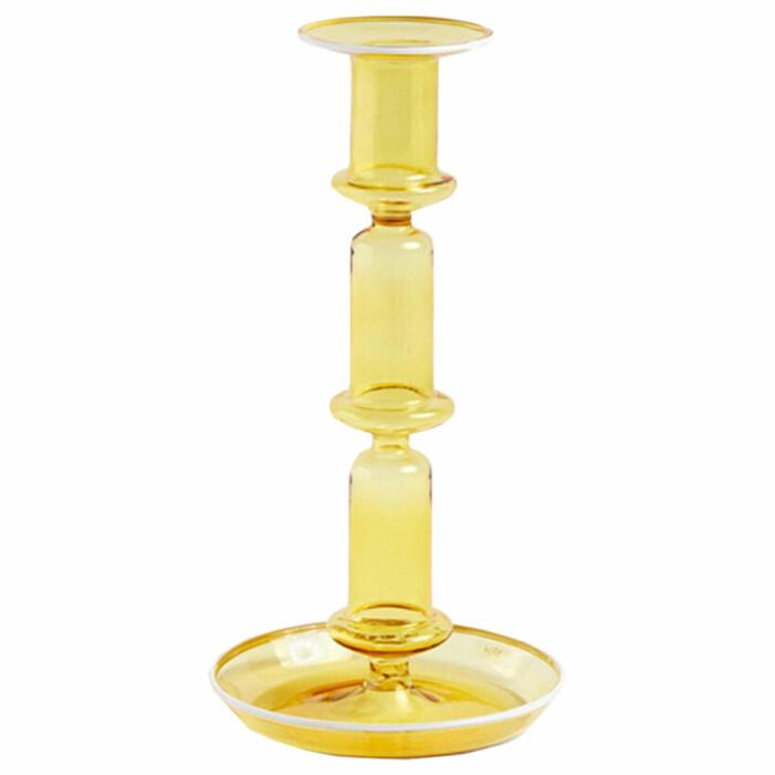gul ljusstake i glas från hay