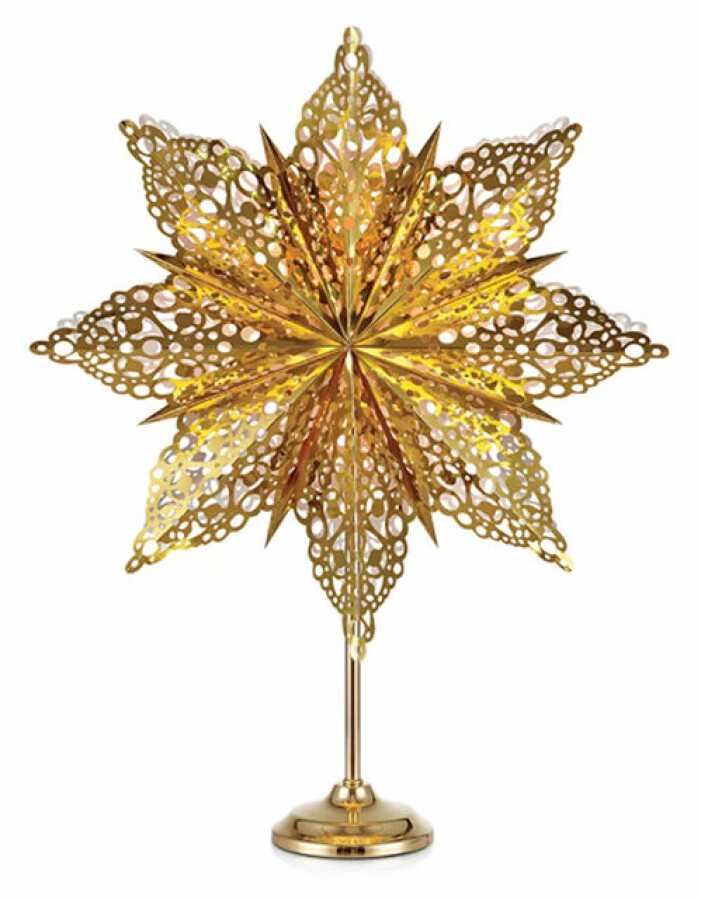 guldig stjärna på fot från markslöjd