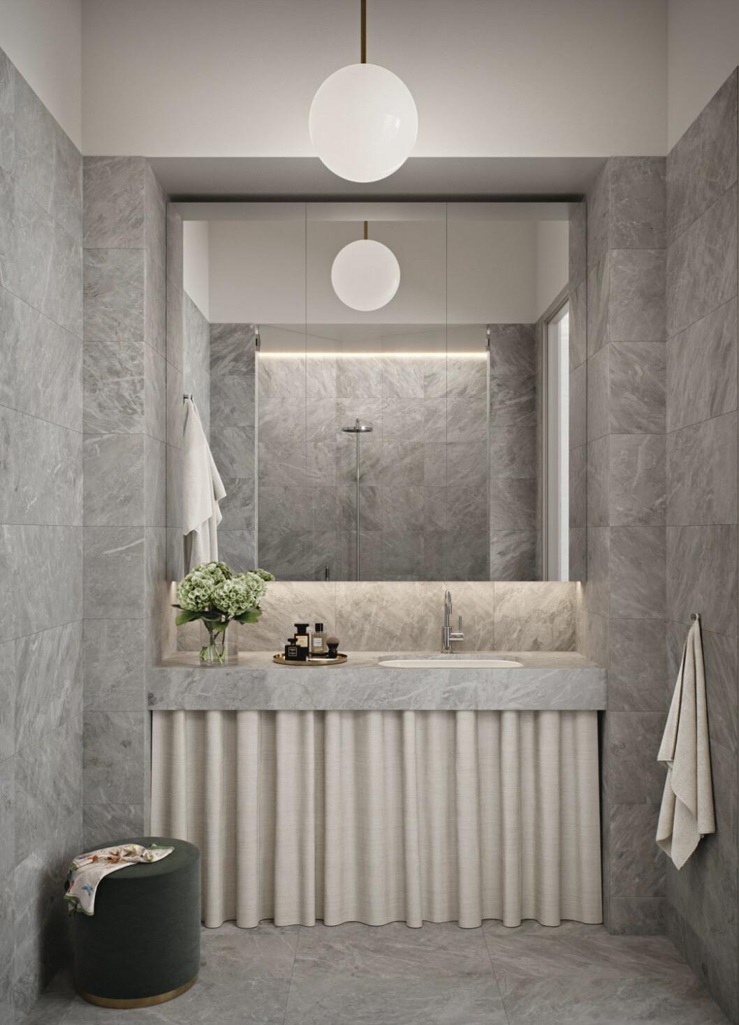 Materialer i badrummen är genomgående ljusgrå marmor med inspiration från en av Tony Craggs stenskulpturer i serien Lost in thought.