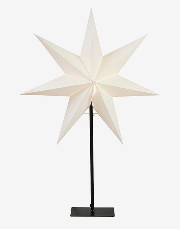pappersstjärna på fot från star trading