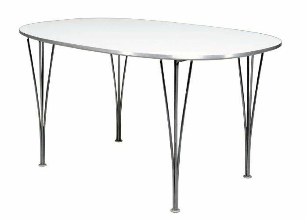 Superellips av Bruno Mathsson.. Vit oval bordsskiva med fyra stålben
